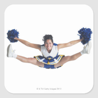 an ethnic teenage female cheerleader jumps high square sticker