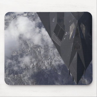 An F-117A Nighthawk flies high over the mountai Mouse Pad