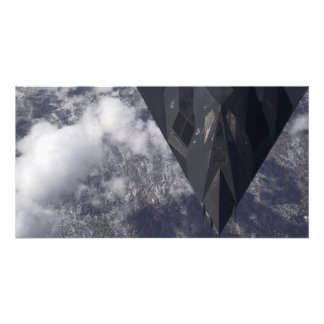 An F-117A Nighthawk flies high over the mountai Photo Print