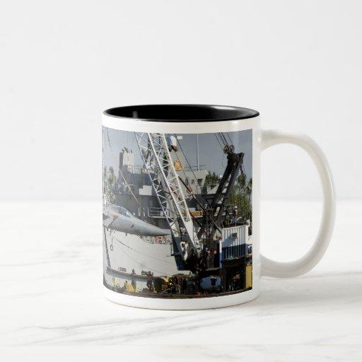 An F-15 Eagle gets a lift from a barge crane Coffee Mug