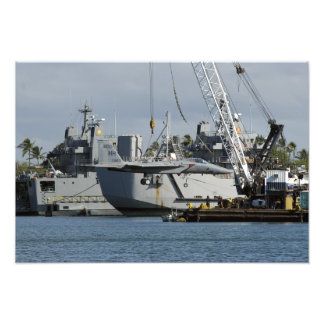 An F-15 Eagle gets a lift from a barge crane Art Photo