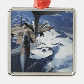 An F-15C Eagle aircraft sits behind a KC-135R Christmas Tree Ornament