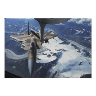 An F-15C Eagle aircraft sits behind a KC-135R Posters