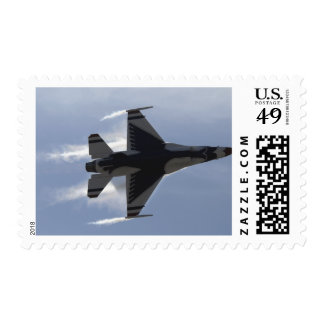 An F-16 Fighting Falcon pulls high G's Postage Stamp