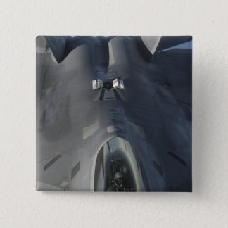 An F-22 Raptor moves into position to receive f Pinback Button