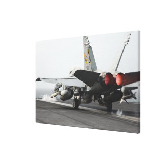 An F/A-18C Hornet launches from the flight deck 2 Canvas Print