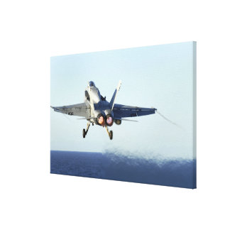 An F/A-18C Hornet launches from the flight deck Canvas Print
