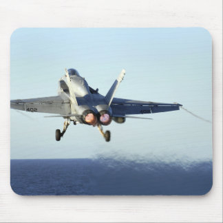 An F/A-18C Hornet launches from the flight deck Mouse Pad