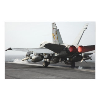 An F/A-18C Hornet launches from the flight deck Photo Print