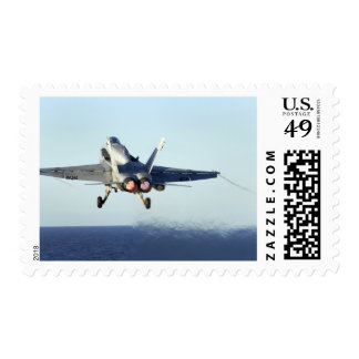 An F/A-18C Hornet launches from the flight deck Stamps
