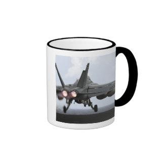 An F/A-18E Super Hornet launches Ringer Mug