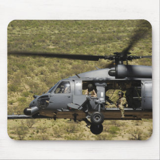 An HH-60 Pave Hawk flies over the desert Mouse Pad