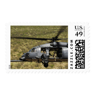 An HH-60 Pave Hawk flies over the desert Stamp