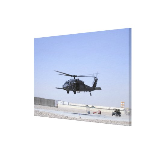 An HH-60G Pave Hawk taking off from Camp Bastio Canvas Print