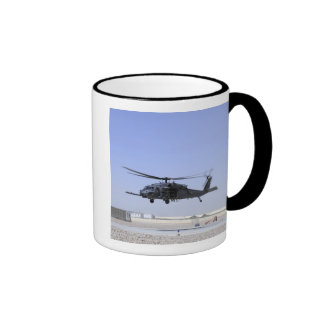 An HH-60G Pave Hawk taking off from Camp Bastio Coffee Mugs