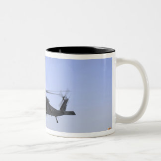 An HH-60G Pave Hawk taking off from Camp Bastio Coffee Mug