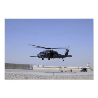 An HH-60G Pave Hawk taking off from Camp Bastio Poster