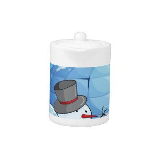 an igloo and snowmen teapot