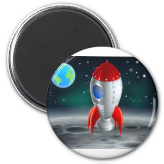 An illustration of a cartoon retro space rocket sh 2 inch round magnet