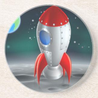 An illustration of a cartoon retro space rocket sh coaster