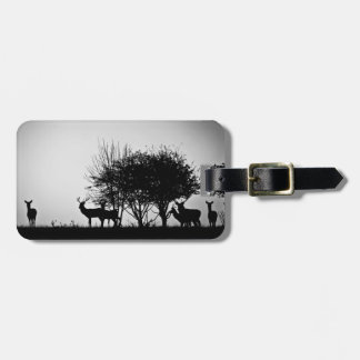 An image of some deer in the morning mist bag tag