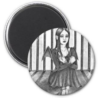An imprisoned angel 2 inch round magnet
