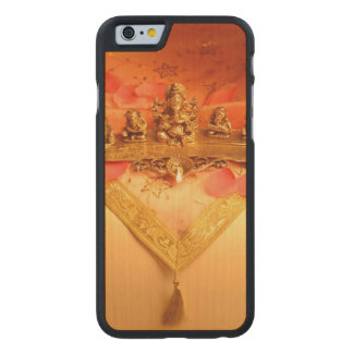 An Indian lamp with Ganesha Idol Carved® Maple iPhone 6 Case