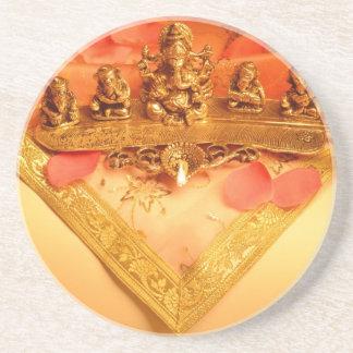 An Indian lamp with Ganesha Idol Drink Coaster