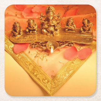 An Indian lamp with Ganesha Idol Square Paper Coaster