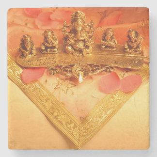 An Indian lamp with Ganesha Idol Stone Coaster