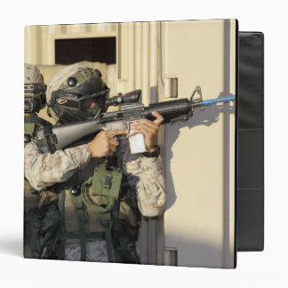 An infantry scout aims his weapon binder