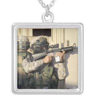 An infantry scout aims his weapon custom jewelry