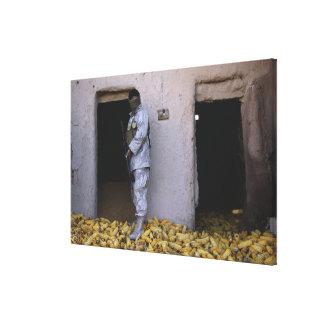 An Iraqi army soldier checks a storage room Canvas Print
