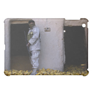 An Iraqi army soldier checks a storage room Case For The iPad Mini
