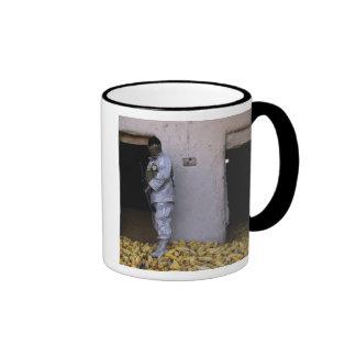 An Iraqi army soldier checks a storage room Ringer Coffee Mug
