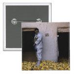 An Iraqi army soldier checks a storage room Pin