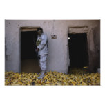 An Iraqi army soldier checks a storage room Poster