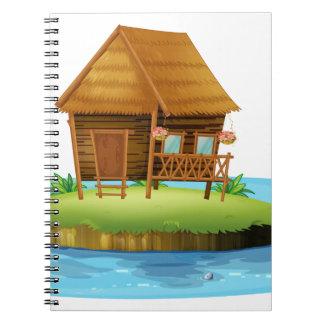 An island with a small nipa hut notebooks