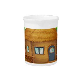 An island with a small nipa hut drink pitchers