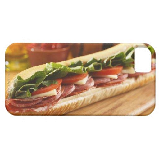 An Italian sub sandwich with 2 Blackberry Bold Cover