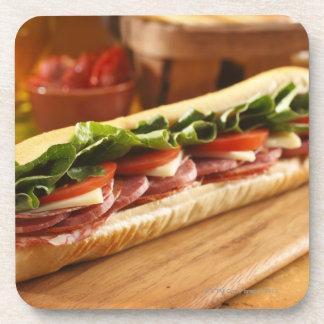 An Italian sub sandwich with 2 Coaster