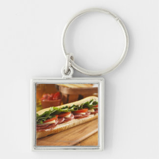 An Italian sub sandwich with 2 Silver-Colored Square Keychain