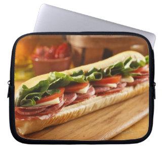 An Italian sub sandwich with 2 Laptop Sleeve