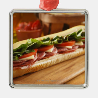 An Italian sub sandwich with 2 Square Metal Christmas Ornament
