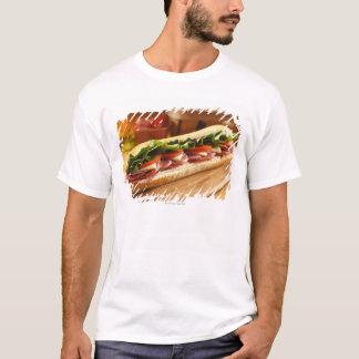 An Italian sub sandwich with 2 T-Shirt