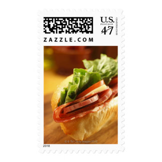 An Italian sub sandwich with Postage