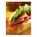 An Italian sub sandwich with Postcard
