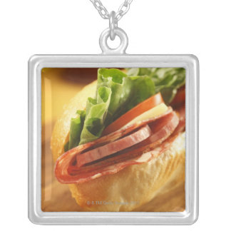 An Italian sub sandwich with Silver Plated Necklace