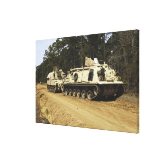 An M-88 recovery vehicle begins to tow an M992 Canvas Print