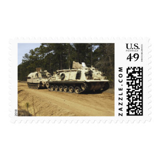 An M-88 recovery vehicle begins to tow an M992 Postage Stamp